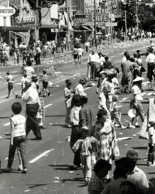 Trash in the streets following the 1964 Days of '47 parade in Salt Lake City.