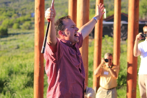 Sen. Mike Lee cheers after hitting a golf ball into Witts Lake during the 2nd annual Rocky Mountain Conservatives barbecue held at Greg Peterson's cabin near Heber on July 1, 2011.