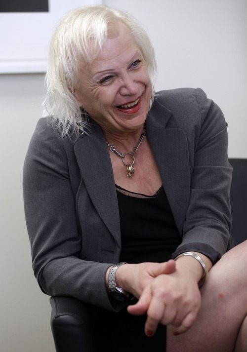 Rachel Sorrow, a transgender woman, smiles as she attends a therapy session with Dr. Dan Karasic, a psychiatrist with the Center of Excellence for Transgender Health, at San Francisco General Hospital in San Francisco,  Friday, July 20, 2012. The nation's psychiatric establishment is wrestling with questions on proper treatment of transgender people as it works to overhaul its diagnostic manual for the first time in almost two decades. Advocates have spent years lobbying the American Psychiatric Association to rewrite or even remove the categories typically used to diagnose transgender people, arguing that terms like Gender Identity Disorder and Transvestic Fetishism promote discrimination by broad-brushing a diverse population with the stigma of mental illness. (AP Photo/Marcio Jose Sanchez)