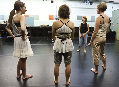 Leah Hogsten  |  The Salt Lake Tribune Nancy Carter (right) talks with the trio of dancers during rehearsal of her work