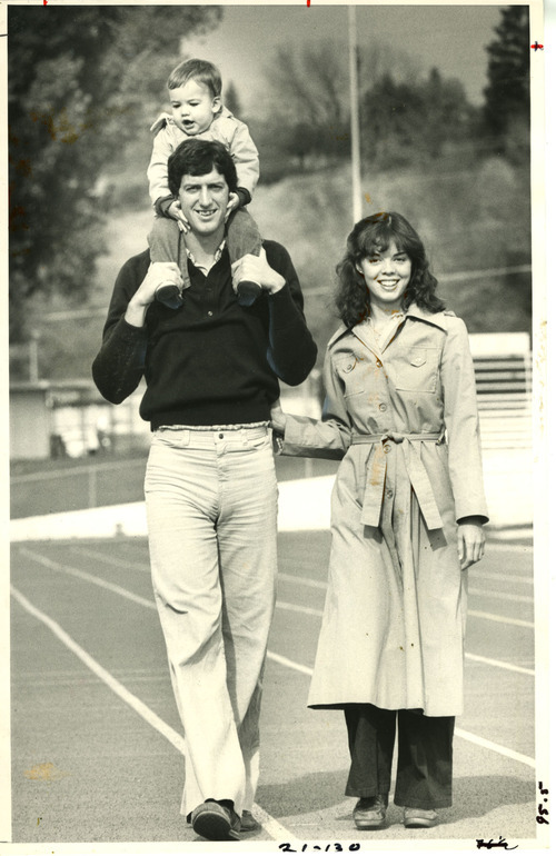 Tribune File Photo Former BYU quarterback Marc Wilson carrying his son, Travis, with wife Colleen Wilson. 1979.