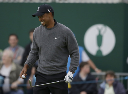 Tiger Woods of the United States reacts after a birdie on the 18th hole at Royal Lytham & St Annes golf club during the second round of the British Open Golf Championship, Lytham St Annes, England, Friday, July 20, 2012. (AP Photo/Chris Carlson)