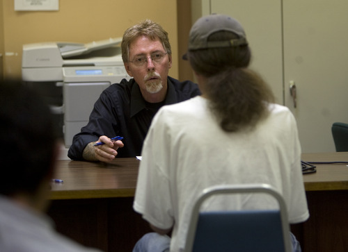 Kim Raff | The Salt Lake Tribune Judge John L. Baxter talks to a defendant during court held for homeless or transient people in the Weigand Center in Salt Lake City, Utah on July 13, 2012. Since May 2004, Salt Lake City has operated a homeless court, one of 25 in existence, where transients can handle misdemeanor charges without showing up in regular court. This helps the homeless person by clearing outstanding warrants they have in a less intimidating environment and it also benefits the regular court by reducing its backlog of such cases. It's part of a larger effort on the part of the American Bar Association to decriminalize homelessness.