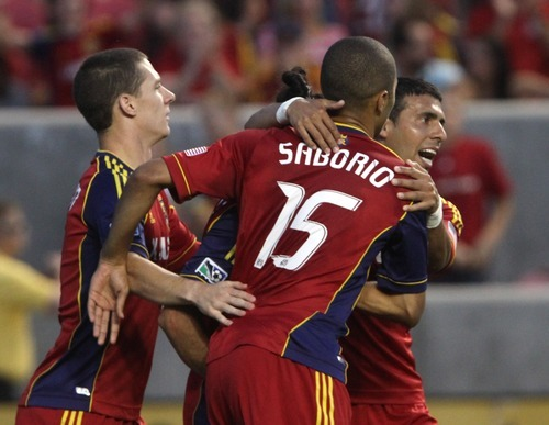 Rick Egan  | The Salt Lake Tribune   Real Salt Lake midfielder Javier Morales (11) (right) congratulates Real Salt Lake forward Alvaro Saborio (15) after he scored the first goal for Salt Lake, in game action, Real Salt Lake vs. The Colorado Rapids, Saturday, July 21, 2012.