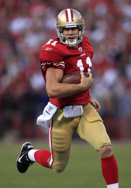 San Francisco 49ers and former Utah quarterback Alex Smith, above, and ex-Ute coach Urban Meyer agree on one thing: Utah needs to keep playing BYU in football. (AP Photo/Marcio Jose Sanchez)