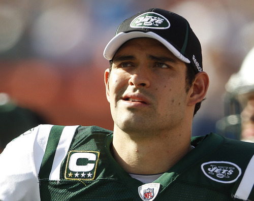 New York Jets quarterback Mark Sanchez (6) looks up from the sidelines during the second half of an NFL football game against the Miami Dolphins,  Sunday, Jan. 1, 2012, in Miami. (AP Photo/Lynne Sladky)