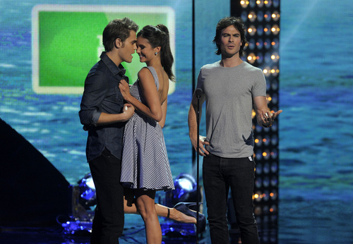 From left, Paul Wesley, Nina Dobrev and Ian Somerhalder are seen onstage at the Teen Choice Awards on Sunday, Aug. 7, 2011 in Universal City, Calif.  (AP Photo/Chris Pizzello)