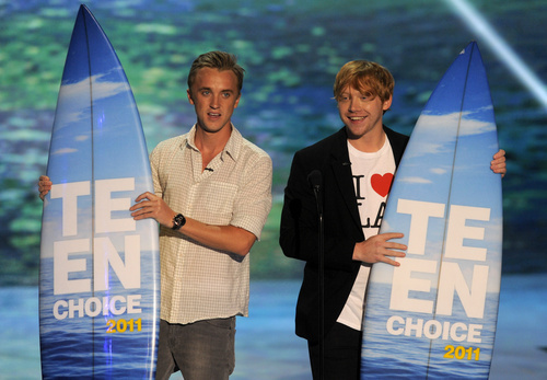 From left, Tom Felton and Rupert Grint are seen onstage with the
