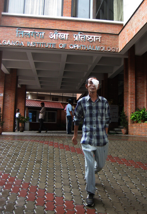 Tony Semerad  |  The Salt Lake Tribune  An eye surgery patient leaves Tilganga Eye Centre in Kathmandu, Nepal, one of hundreds receiving care at the ground-breaking clinic in a given day. Tilganga has restored vision to hundreds of thousands of blind residents and brought high-quality, inexpensive eye surgeries to one of the world's poorest regions-- with help and inspiration from Geoffrey Tabin, a top ophthamologist at John A. Moran Eye Center in Salt Lake City.