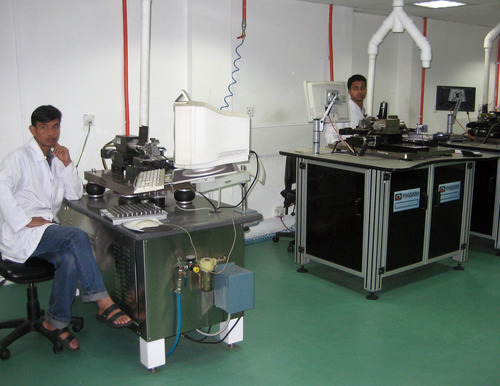 Tony Semerad  |  The Salt Lake Tribune  Part of the lens implant manufacturing facilities at Tilganga Eye Clinic in Kathmandu, Nepal. The plant makes hard intraocular lenses for less than $3.50 apiece, compared to nearly $100 per lens in America. It produces about 30,000 lenses monthly, with each 18-millimeter diameter circle of glass machined to exacting international standards. Lens are exported to Pakistan, China, Turkey and elsewhere to subsidize patient care. Tilganga clinic has restored vision to hundreds of thousands of blind Nepali and brought high-quality, inexpensive eye surgeries to one of the world's poorest regions-- with pivotal help and inspiration from a top ophthamologist at Moran Eye Center in Salt Lake City.