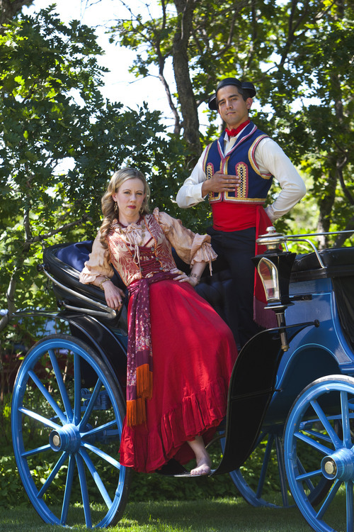 Chris Detrick  |  The Salt Lake Tribune Opera singers Demaree Brown and Daniel Tuutau pose for a portrait Tuesday July 17, 2012. They will be singing and riding in this carriage in the Pioneer Day Parade.