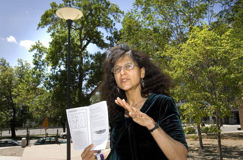 Paul Fraughton   Salt Lake Tribune University of Utah scientist, Nalini Nadkarni,  directs a tour of the trees at the Cathedral Church of Saint Mark using a  guide book  which she gave to  people attending her lecture, pointing out the names of the trees planted around the cathedral as well as religious references to trees.  Tuesday, July 17, 2012