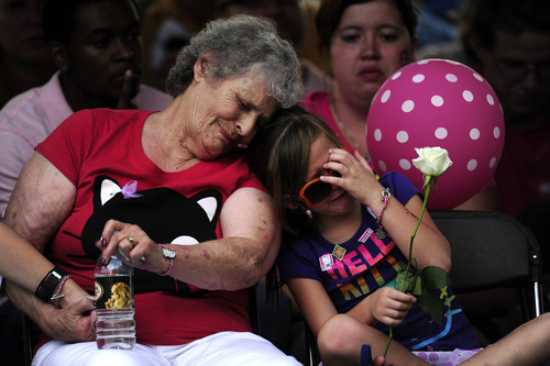 Family members of the victims of the Century 16 theater shooting remember their loved ones during a vigil at the Aurora Municipal Center campus in Aurora, Colo. Sunday, July 22, 2012. 12 people were killed and 58 were injured in a shooting during an early Friday premiere of