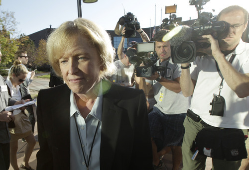 Carol Chambers, Arapahoe County District Attorney, arrives at the county courthouse, Monday, July 23, 2012, in Centennial, Colo., the day of the first court appearance of James E. Holmes, who is being held on suspicion of first-degree murder, and who could also face additional counts of aggravated assault and weapons violations, stemming from a mass shooting last Friday in a movie theater in Aurora, Colo., that killed 12 and injured dozens of others. (AP Photo/Ted S. Warren)