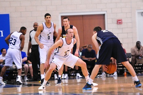 Blake Ahearn (2), of the Utah Jazz defends Ben Hansborough of the Indiana Pacers during the Orlando Summer League games Thursday, July 12, 2012 in Orlando, Florida.  (Photo by Roberto Gonzalez|Special to the Tribune)