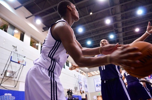 Alec Burks of the Utah Jazz inbounds the ball against Orlando Johnson of the Indiana Pacers during the Orlando Summer League games Thursday, July 12, 2012 in Orlando, Florida.  (Photo by Roberto Gonzalez|Special to the Tribune)
