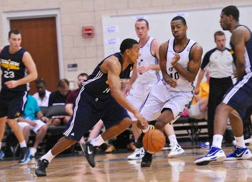 Alec Burks runs into a pick while playing Orlando Johnson, (11) of the Utah Jazz play the Indiana Pacers during the Orlando Summer League games Thursday, July 12, 2012 in Orlando, Florida.  (Photo by Roberto Gonzalez|Special to the Tribune)