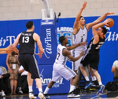 Mike Green (17), and Enes Kanter (0) of the Utah Jazz defend Ben Hansborough of the Indiana Pacers during the Orlando Summer League games Thursday, July 12, 2012 in Orlando, Florida.  (Photo by Roberto Gonzalez|Special to the Tribune)