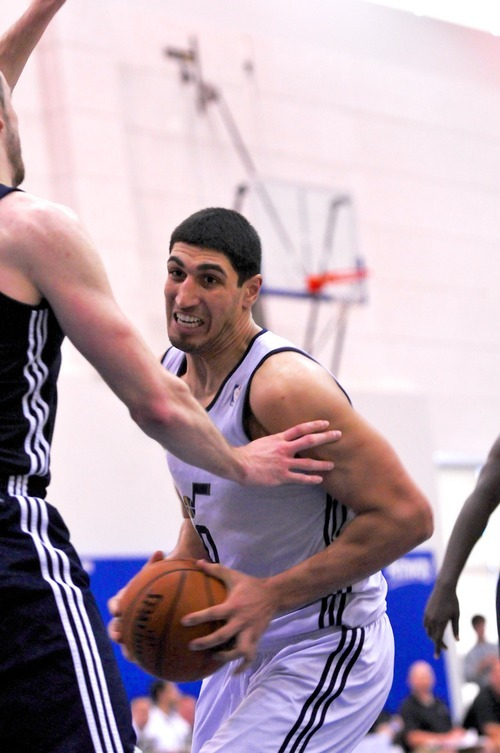 Enes Kanter of the Utah Jazz drives to the basket against the Indiana Pacers during the Orlando Summer League games Thursday, July 12, 2012 in Orlando, Florida.  (Photo by Roberto Gonzalez|Special to the Tribune)