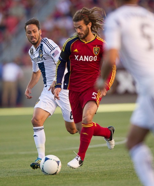 Trent Nelson  |  The Salt Lake Tribune RSL's Kyle Beckerman with the ball and LA's Marcelo Sarvas defending as Real Salt Lake hosts the L.A. Galaxy at Rio Tinto Stadium on Wednesday, June 20, 2012, in Sandy.