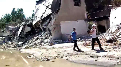 This citizen journalism image provided by Ugarit News, taken on Monday, July 23, 2012, purports to show the destruction from fighting in the Mazza district of Damascus, Syria. (AP Photo/Ugarit News) THE ASSOCIATED PRESS IS UNABLE TO INDEPENDENTLY VERIFY THE AUTHENTICITY, CONTENT, LOCATION OR DATE OF THIS CITIZEN JOURNALIST IMAGE