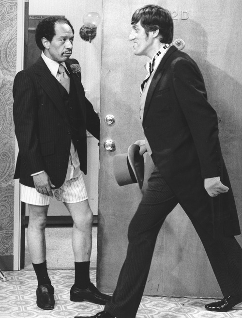In this 1977 file photo provided by CBS, Sherman Hemsley, left, and Paul Benedict star in an episode of