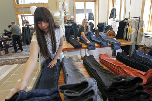Al Hartmann  |  The Salt Lake Tribune   The Chalk Garden is being reborn at 74 South Main Street. Employee Josephine Sun sets up clothing displays Wednesday July 25.  It sits at the northwest corner of 100 South and Main Street in an old bank building.