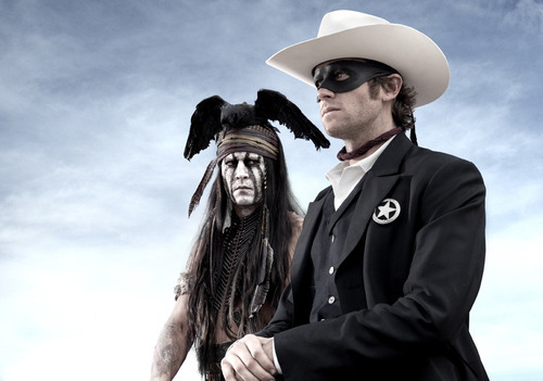 An undated  publicity photo from Disney/Bruckheimer Films, shows actors, Johnny Depp, left, as Tonto, a spirit warrior on a personal quest, who joins forces in a fight for justice with Armie Hammer, as John Reid, a lawman who has become a masked avenger.  In New Mexico, where some of the movie was filmed, the Navajo presented Depp, his co-star Hammer, director Gore Verbinski and producer Bruckheimer with Pendleton blankets to welcome them to their land. Elsewhere, the Comanche people of Oklahoma made Depp, an honorary member. The film releases summer 2013. (AP Photo/Disney/Bruckheimer Films, Peter Mountain)