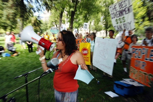 Steve Griffin | The Salt Lake Tribune Henia Belalia, director of Peaceful Uprising, talks during the group's protest on Thursday. The organization argues government is controlled by big business.