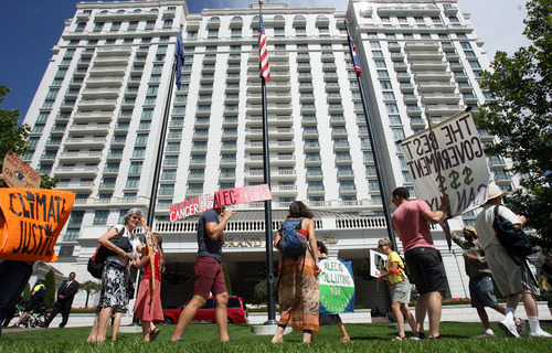 Steve Griffin | The Salt Lake Tribune Supporters of eco-activist Tim DeChristopher protested in downtown Salt Lake City to mark the one-year anniversary of DeChristopher's prison term and the annual conference of the American Legisaltive Exchange Council. Demonstrators say both the conviction and the conference are signs of oversized corporate clout on public policy.