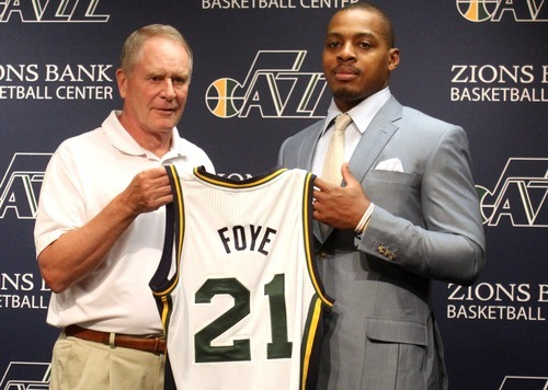 Rick Egan  | The Salt Lake Tribune   Utah Jazz general manager, Kevin O' Connor presents Randy Foye with his new jersey, during a press conference at Zion's Bank Basketball Center, Thursday, July 26, 2012.