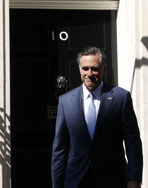 Charles Dharapak  |  The Associated Press Republican presidential candidate Mitt Romney walks out of 10 Downing Street after meeting with British Prime Minister David Cameron in London Thursday.