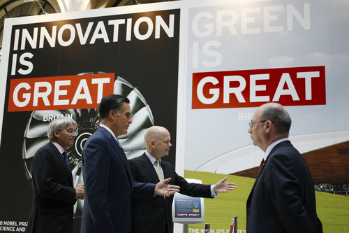 Republican presidential candidate and former Massachusetts Gov. Mitt Romney, second left, tours the GREAT Pavillion Exhibit with British Foreign Secretary William Hague in London, Thursday, July 26, 2012. (AP Photo/Charles Dharapak)