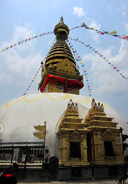 The towering stupa at the top of Swayambhunath Stupa in Kathmandu, Nepal. Also known as the Monkey Temple, the ancient mountain complex of shrines, monuments, statuary and hundreds of spinning prayer wheels is considered among the most sacred Buddhist sites in the Kathmandu valley. The top of Swayambhunath is reached by a steep set of stone stairs. Courtesy of Jared Kee