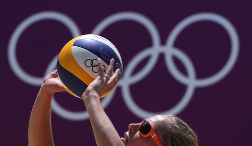 Sanna Keizer from Netherlands plays a ball during a practice session for the Beach Volleyball women competition at the 2012 Summer Olympics, Thursday, July 26, 2012, in London. (AP Photo/Petr David Josek)