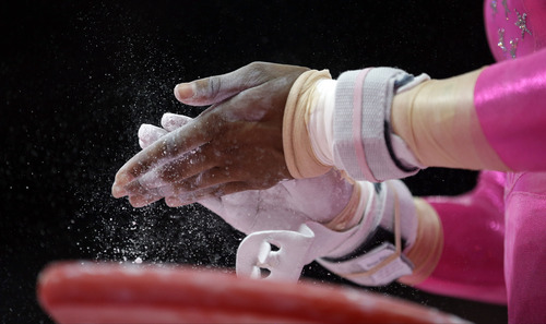 U.S. gymnast Jordyn Wieber chalks her hands before a performance during training at the 2012 Summer Olympics, Thursday, July 26, 2012, in London. (AP Photo/Julie Jacobson)