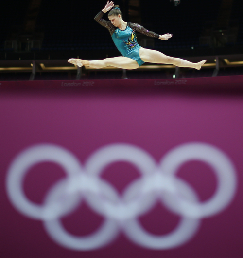 An Australian gymnast performs on the beam during training at the 2012 Summer Olympics, Thursday, July 26, 2012, in London. (AP Photo/Matt Dunham)