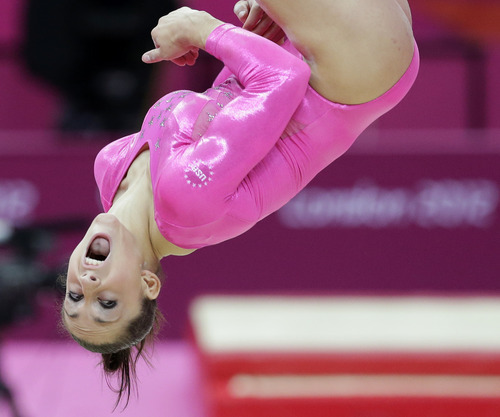U.S. gymnast Mc Kayla Maroney performs during training at the 2012 Summer Olympics, Thursday, July 26, 2012, in London. (AP Photo/Julie Jacobson)