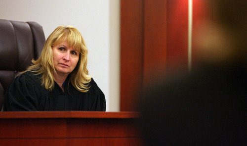 Steve Griffin | The Salt Lake Tribune Judge Katherine Bernards-Goodman listens to attorneys during a bail hearing for Republican activist and alleged serial date-rapist Gregory Peterson at the Matheson Courthouse in Salt Lake City Wednesday July 25, 2012. Peterson, 37, of Orem, is accused of raping four women -- two of whom say they were taken to a Heber cabin where Peterson has hosted major political events.