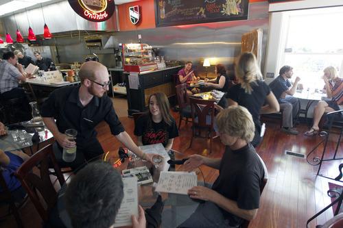 Al Hartmann  |  The Salt Lake Tribune   Server Derek Kitchen waits on lunch diners at Avenues Bistro on Third.