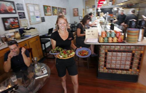 Al Hartmann  |  The Salt Lake Tribune   Ellie Weeks serves lunch diners at Avenues Bistro on Third.