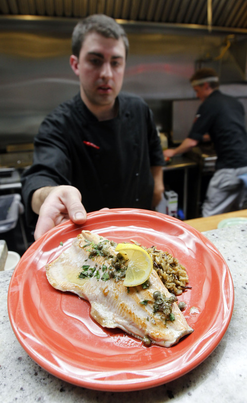 Al Hartmann  |  The Salt Lake Tribune   Chef Henry Brail serves Everett Ruess Grilled Trout with lemon, capers, garlic white wine butter sauce with rice at Avenues Bistro on Third.