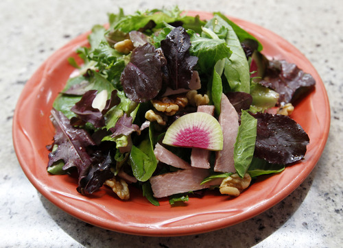 Al Hartmann  |  The Salt Lake Tribune   Christaino's special salad plate at Avenues Bistro on Third features Gran Cotto Ham, walnuts, sliced radish, arugula and a spring mix of lettuces.