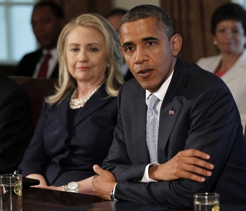 Secretary of State Hillary Rodham Clinton listens at left as President Barack Obama speaks to members of the media during a Cabinet Meeting in the Cabinet Room of the White House in Washington, Thursday, July, 26, 2012.  (AP Photo/Pablo Martinez Monsivais)