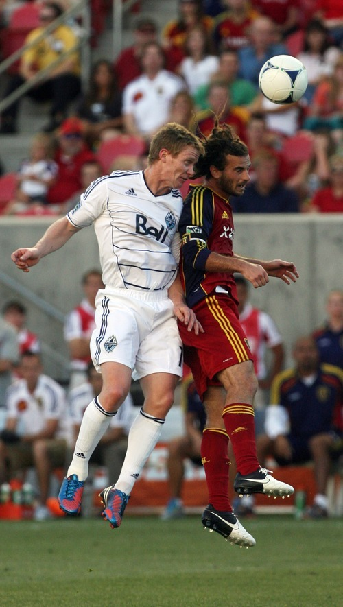 Kim Raff | The Salt Lake Tribune (right) Real Salt Lake player Kyle Beckerman and Vancouver player (left) Barry Robson battle for a head ball during a game at Rio Tinto Stadium in Sandy, Utah on July 27, 2012.