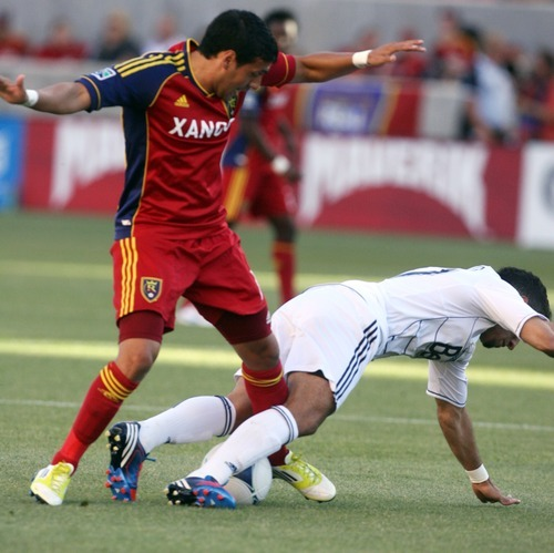 Kim Raff | The Salt Lake Tribune Real Salt Lake player (left) Javier Morales trips up Vancouver player Camilo (cq) at Rio Tinto Stadium in Sandy, Utah on July 27, 2012.