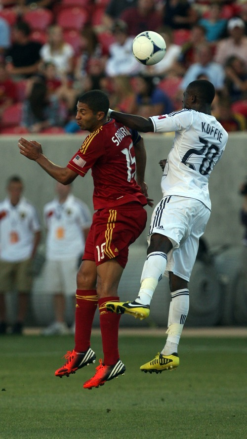Kim Raff | The Salt Lake Tribune Real Salt Lake player (left) Alvaro Saborio and Vancouver player Gershon Koffie battle for a head ball at Rio Tinto Stadium in Sandy, Utah on July 27, 2012.
