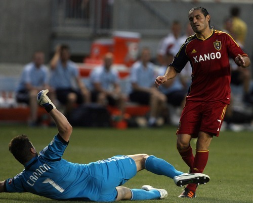 Kim Raff | The Salt Lake Tribune Real Salt Lake player Fabian Espindola collides with Vancouver goalie Joe Cannon at Rio Tinto Stadium in Sandy, Utah on July 27, 2012. Cannon was given a red card as a result of the play. Real Salt Lake went on to win the game 2-1.