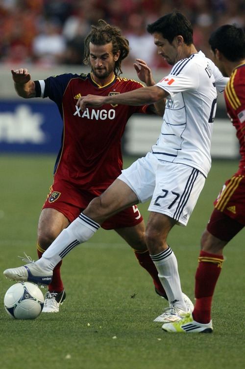 Kim Raff | The Salt Lake Tribune Real Salt Lake player Kyle Beckerman battles for the ball against  Vancouver player Jun Marques Davidson at Rio Tinto Stadium in Sandy, Utah on July 27, 2012. Real Salt Lake went on to win the game 2-1.