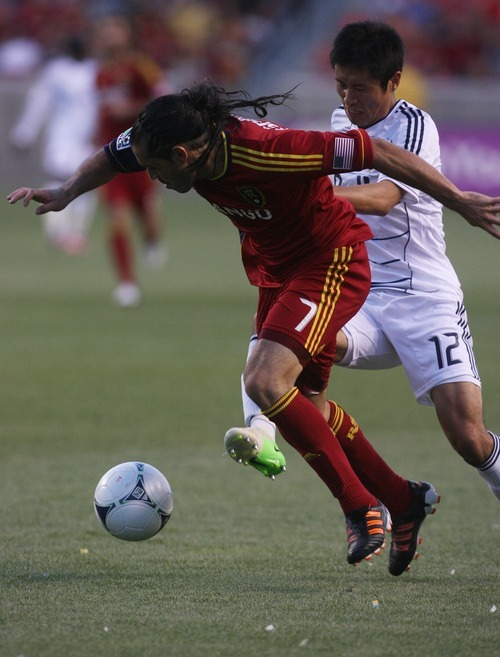 Kim Raff | The Salt Lake Tribune Real Salt Lake player Fabian Espindola dribbles past Vancouver player Lee Young-Pyo at Rio Tinto Stadium in Sandy, Utah on July 27, 2012. Real Salt Lake went on to win the game 2-1.